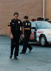 Two Police Officers Walking