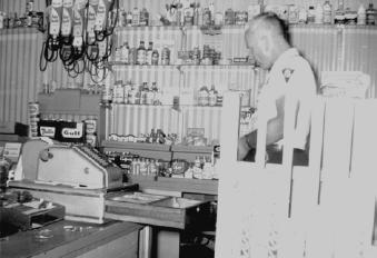 Historical Image of Police Officer at cash register