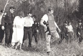 Historical Image of Police Escorting person through woods
