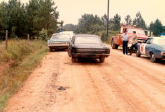 Historical Image of Cars on Dirt Road