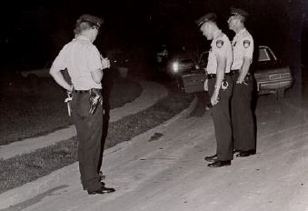 Historical Image of Policemen on Investigating on Street